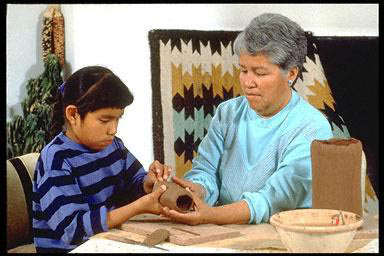 grandparent and child, family, Native Americans, crafts, clay, Pueblo