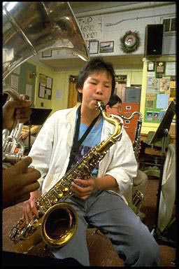 musical instrument, music, multi ethnic, perform, fun, friends, classroom, classmates, class, play, practice, rehearsal, school, work, school band, teacher, teaching, intermediate school, saxophone, interior