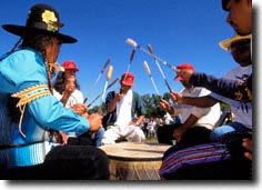 The steady beat of drums and the piercing sound of the drummers song is always present.